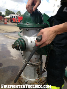 Image demonstrating how to slide hydrant wrench along the chain.