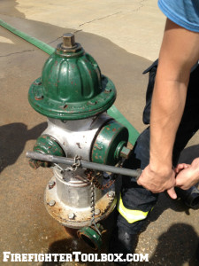 Image demonstrating how to slide a wrapped chain down the shaft of the hydrant wrench.