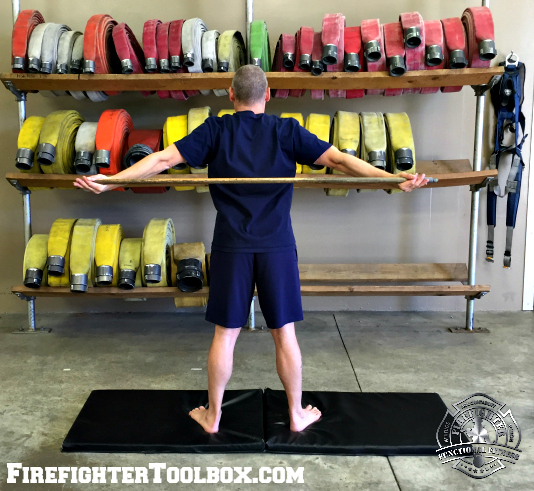 Flexibility_dowel chest opener finish position rear view F3